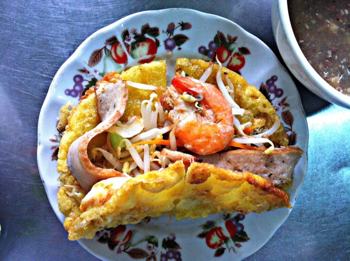 A Bánh Khoái Huế disc in plain view